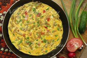 Interessante eiergerechten  Slabonen met ei, tomaten en uien